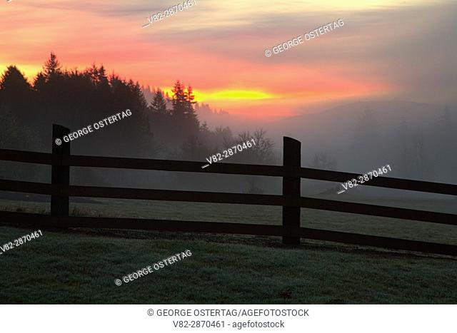 Sunrise with fence, Jewell Meadows Wildlife Area, Oregon