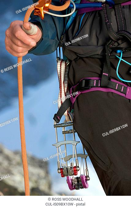 Safety harness worn by mountaineer