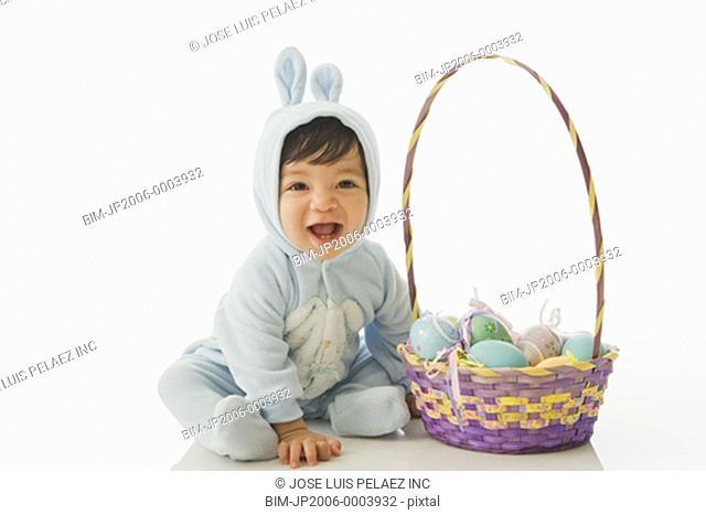 Hispanic baby in Easter Bunny costume