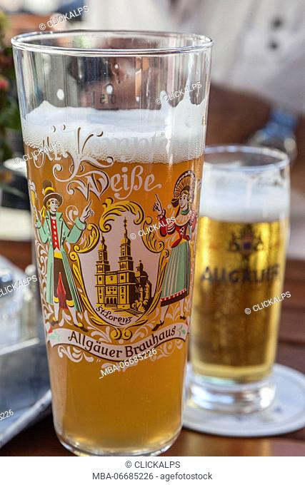 Details of decorated glasses of beer the typical German drink Garmisch Partenkirchen Oberbayern region Bavaria Germany Europe