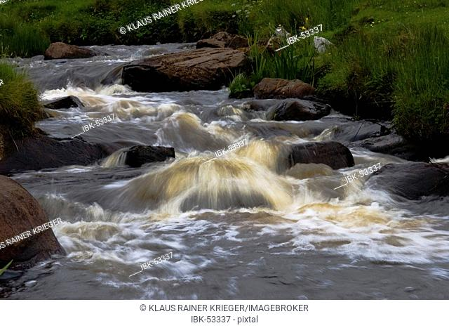 The rivers of the isle of Islay are brown coloured due to the peaty soil
