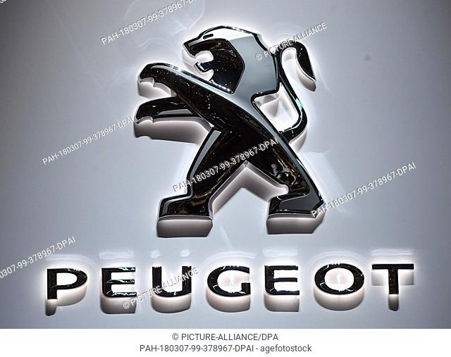 07 March 2018, Switzerland, Geneva: The logo of carmaker Peugeot is displayed at the Peugeot fair stand during the 2nd Press Day at the 2018 Geneva Motor Show