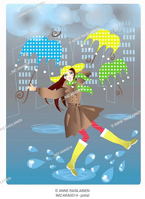 A woman walking in the rain with umbrellas