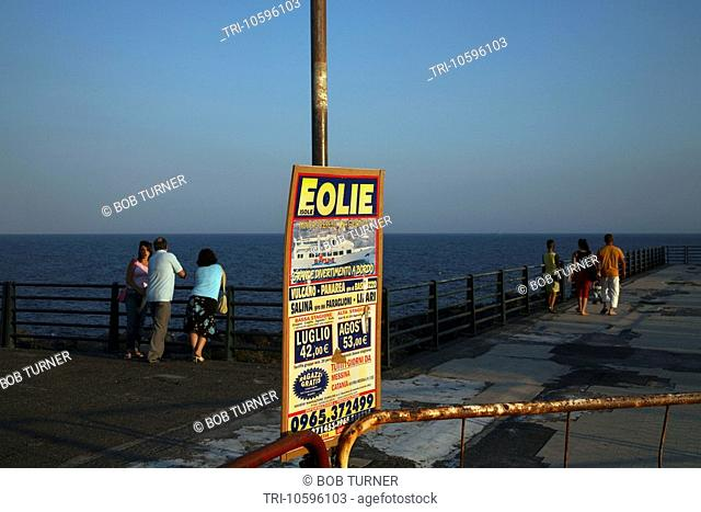 People & Advertising Sign Seafront Catania Sicily Italy
