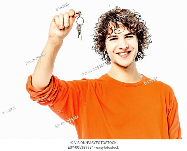 one young man caucasian holding keys portrait in studio white background