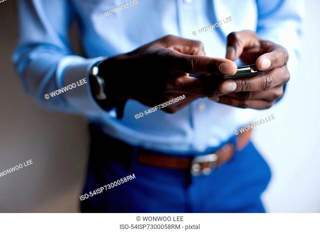 Close up of businessman using cell phone