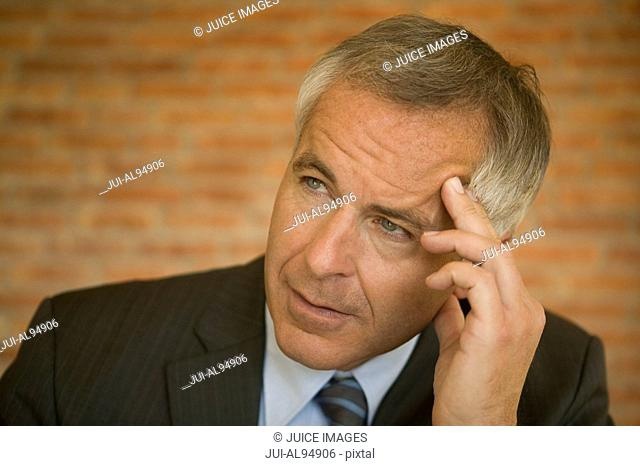 Close-up of concerned mature businessman