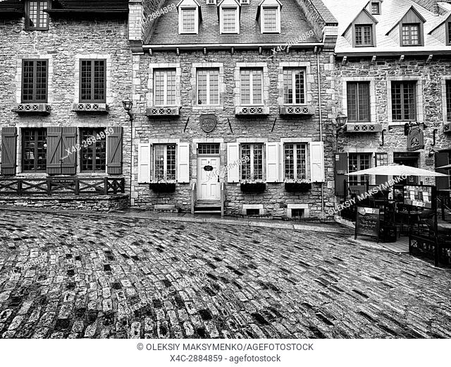 Galerie Place Royale and restaurant La Pizz in Royal Square on a rainy day. Beautiful historic architecture, French style houses in Old Quebec City