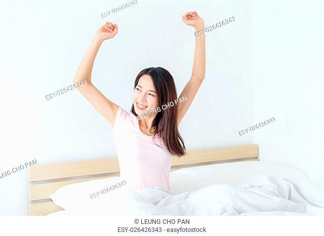 Young woman wake up at early morning