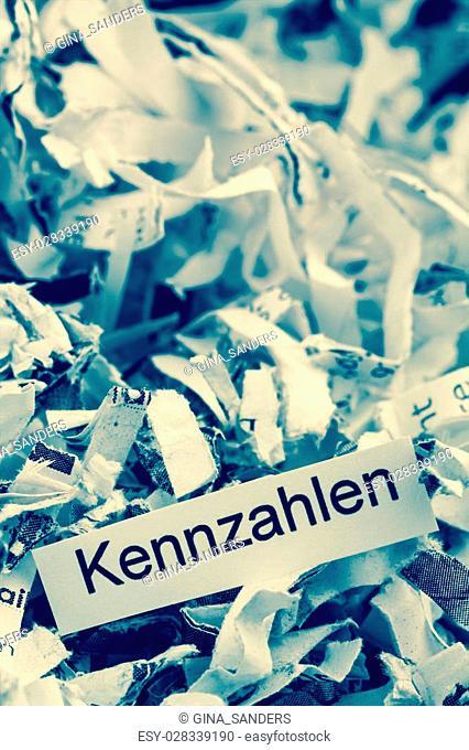 shredded paper for keyword metrics symbolic photo for data destruction, business and economic development