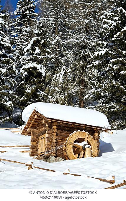 A wooden structure with watermill. Sesto Municipality. Bolzano Province. Trentino-Alto Adige. Italy