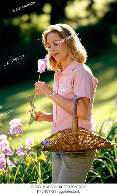 woman picking flowers in her perennial garden