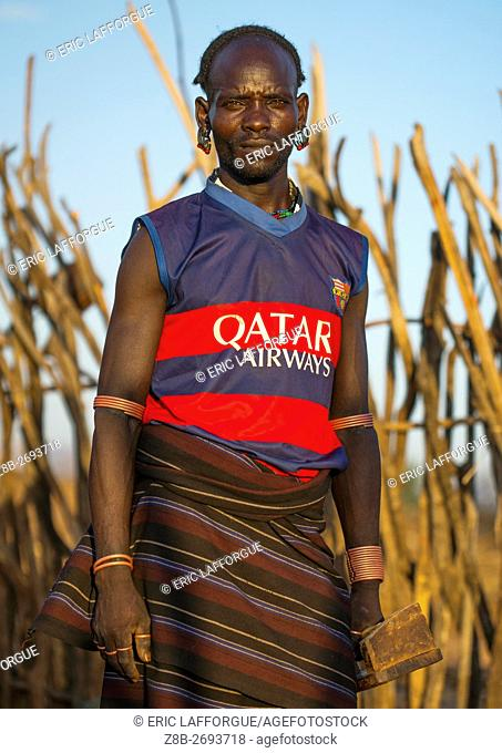Ethiopia, Omo Valley, Turmi, hamer tribe man with paris saint germain football shirt