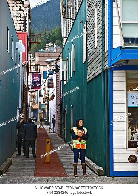 A crossing guard at a narrow alley in Ketchikan, Alaska
