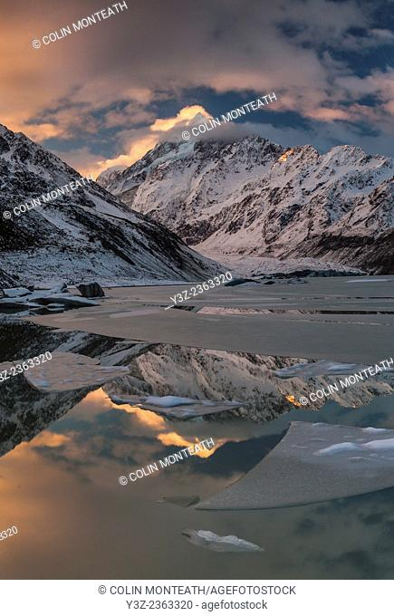 Sunset panorama on ice-covered Hooker lake, Aoraki Mount Cook catches last of winter sun, Mount Cook National Park, Canterury