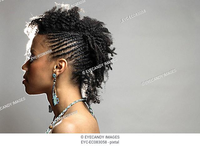 Side view of young stylish African American woman, studio shot