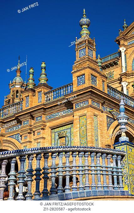 bridge with colorfull tiles at plaza de espana, sevilla, spain