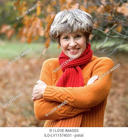 A portrait of a senior woman smiling