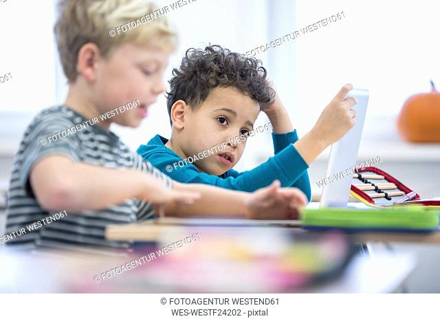 Pupils with tablet in class