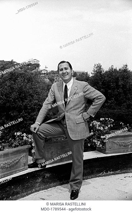 A portrait of Alberto Sordi in the terrace of his house facing the Palatino Hill; the Italian movie star is actually working at a movie with Monica Vitti