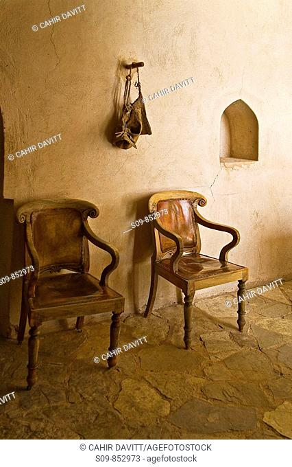 Two chairs and a hanging bag in the fort of Nizwa, Al Jinah, Oman