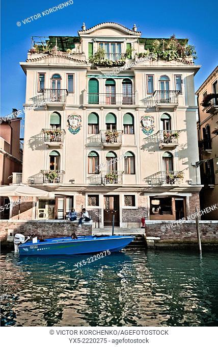 Facade of a hotel facing a canal in Venice