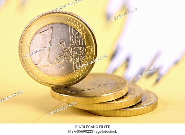 Eurocrisis with batch of euro coins shortly in front of falling down