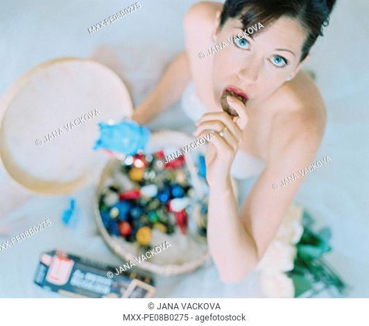 Looking down on woman indulging in chocolate