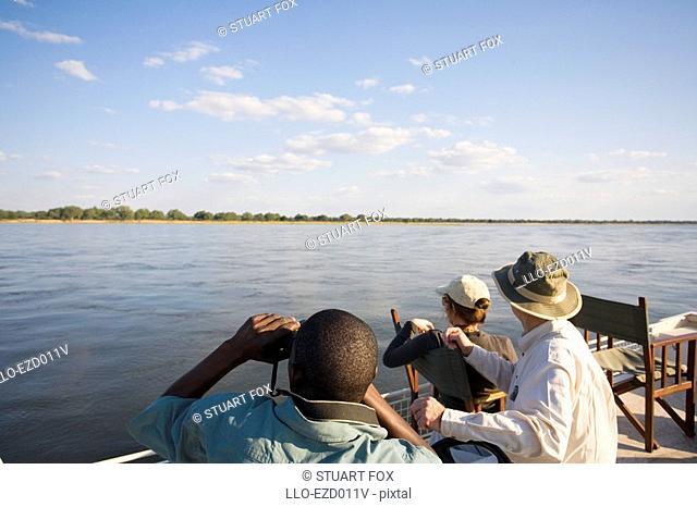 Mature Couple on a Guided Boat Trip Along the Zambezi River  Zambezi River, Southern Province, Zambia