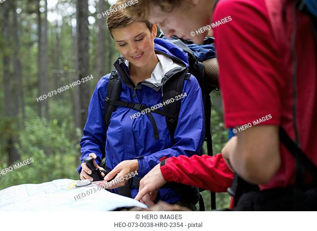 male and female backpackers reviewing trail map