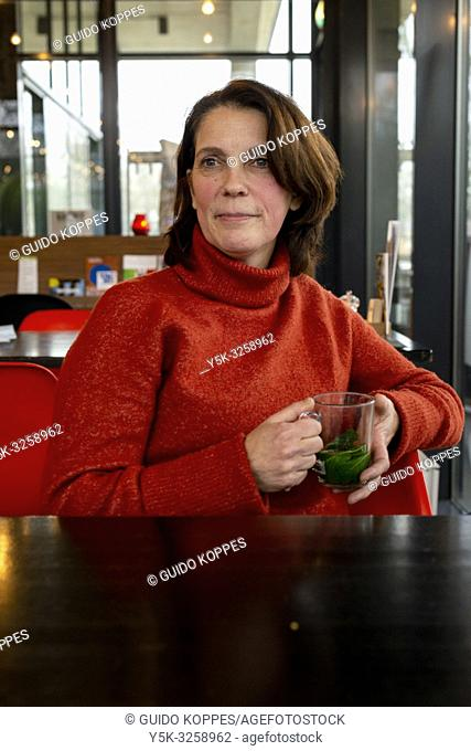 Eindhoven, Netherlands. Portrait of a middle aged, female blogger, who recoverred from a severe Medical Condition: Brest Cancer and lived to tell the world...