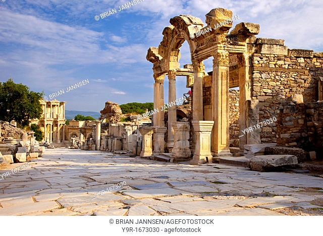Temple of Hadrian with Library of Celsus beyond along paved Street of Curetes in ancient Ephesus, near Selcuk Turkey