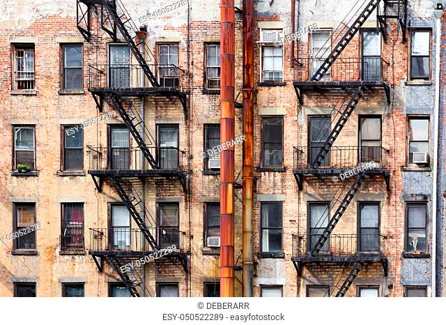 Old dirty apartment buildings facing an alley in New York City