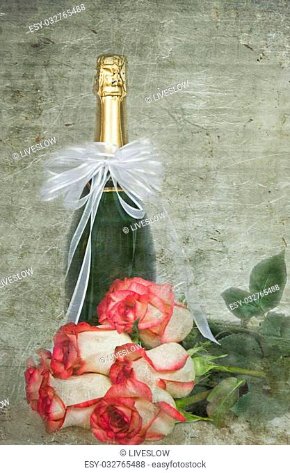 Wine bottle with rose bouquet in textured layers