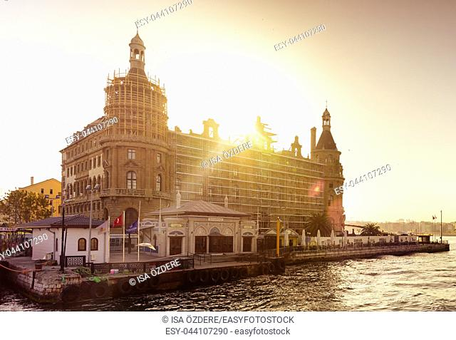Traditional public ferry passes by historical train terminal named Haydarpasa. Until 2012 the station was a major intercity