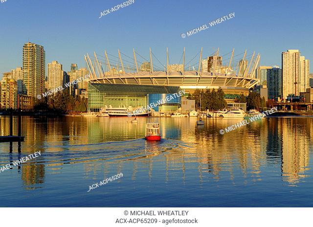 BC Place Stadium and Aquabus passenger ferry, False Creek, Vancouver, British Columbia, Canada