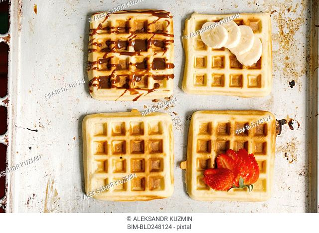 Variety of waffles on pan