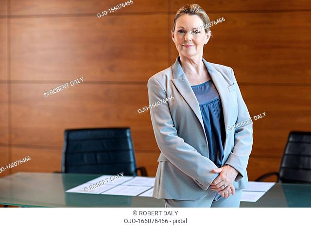 Smiling businesswoman in conference room