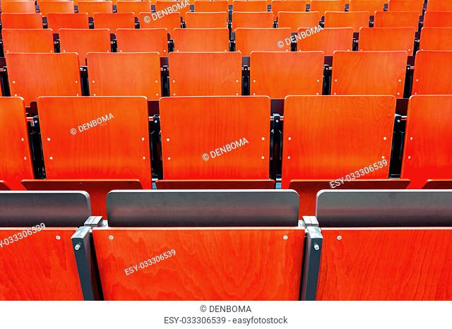 these red chairs in the auditorium from an school