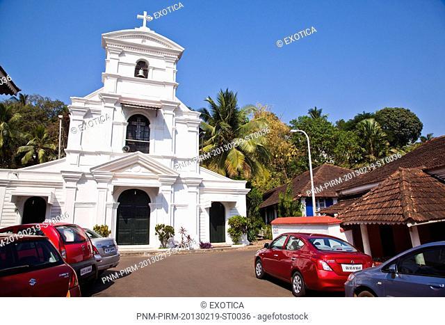 Cars parked outside a church, St Sebastian Chapel, Panaji, North Goa, Goa, India
