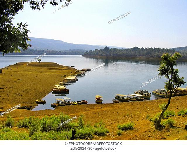 Boating, Koyna dam backwaters. Tapola, Maharasthra, India. The Koyna Dam is one of the largest dams in Maharashtra, India