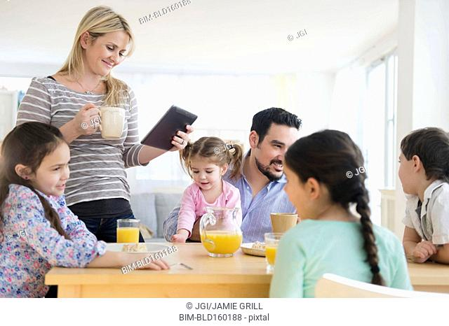 Caucasian family eating breakfast at table