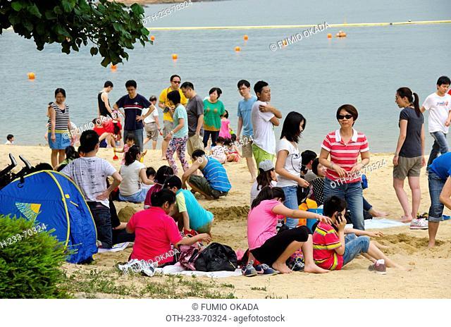 Leisure at Park Island beach, Ma Wan, Hong Kong