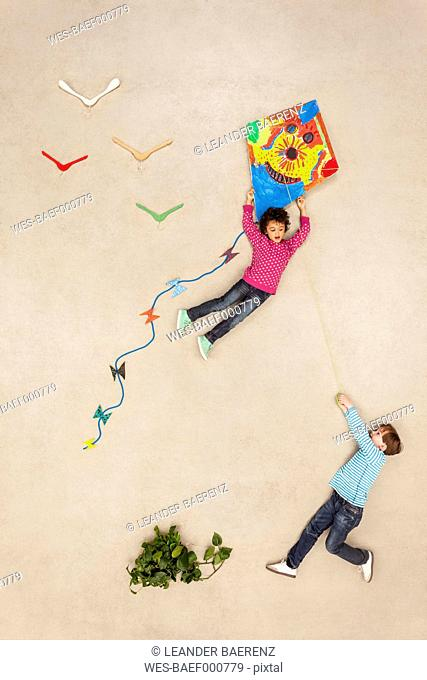 Boys flying kite