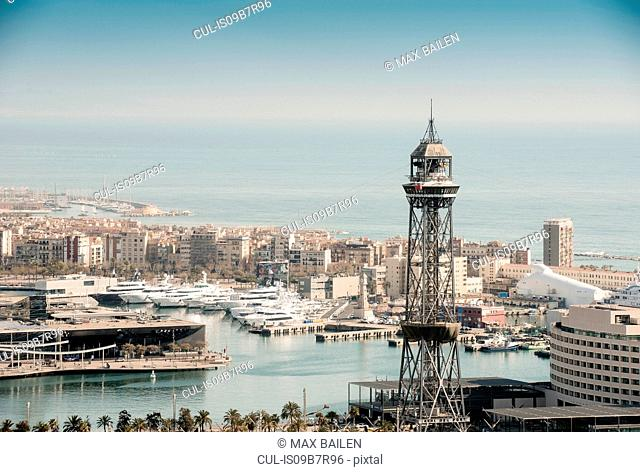 Elevated view of coastal harbour and superyachts, Barcelona, Spain