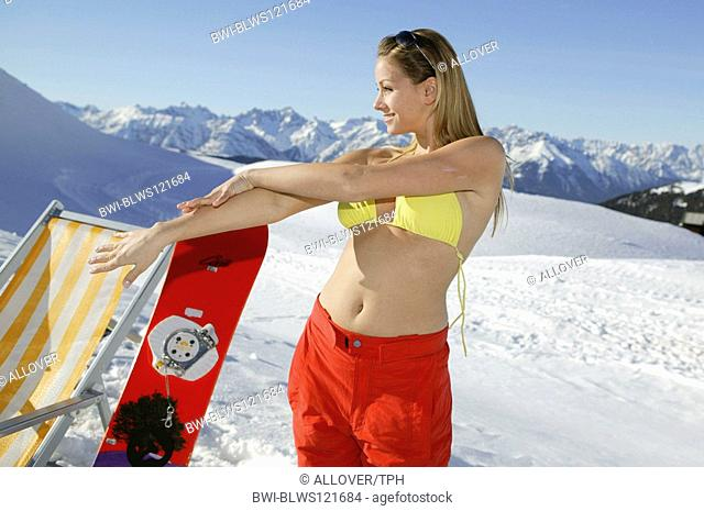 young woman sunbathing at winter holiday