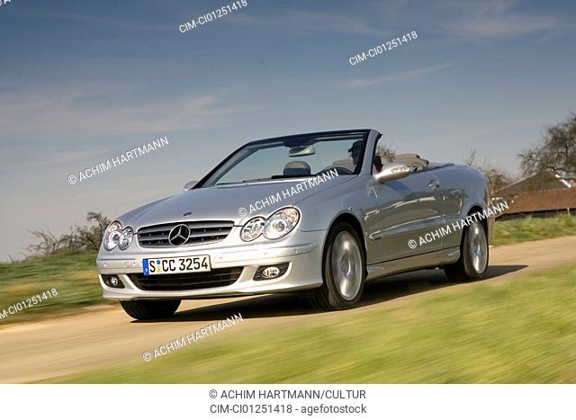 Mercedes CLK 350 Convertible Elegance, model year 2005-, silver, driving, diagonal from the front, frontal view, country road, open top