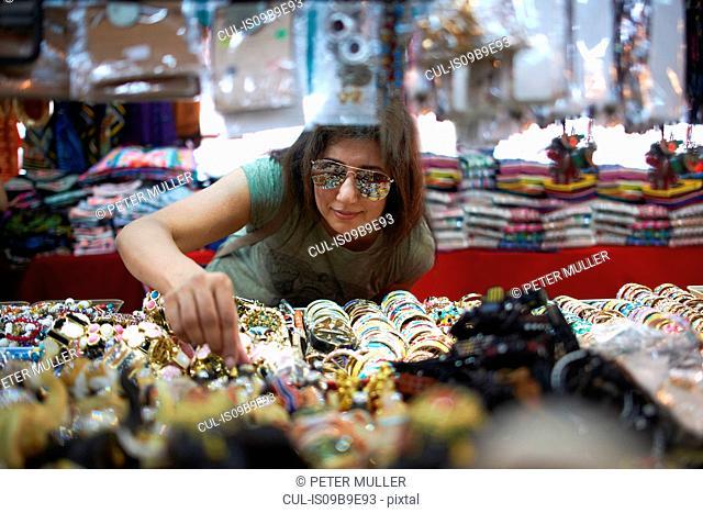 Woman looking at souvenirs on market stall, Bangkok, Krung Thep, Thailand, Asia