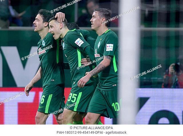 12 March 2018, Germany, Bremen: Soccer, Bundesliga, Werder Bremen vs. 1. FC Cologne at Weserstadion: Bremen's Thomas Delaney (left to right)
