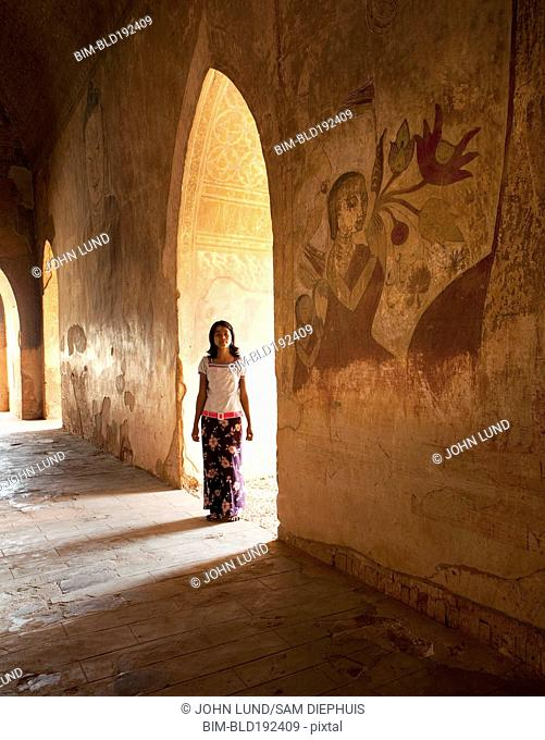 Asian girl standing in archway
